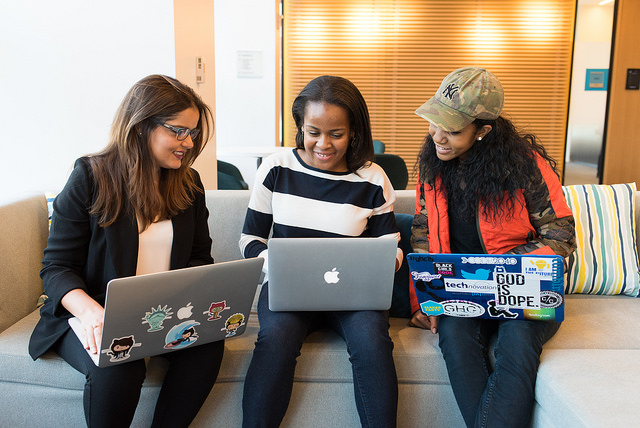 A multiracial group of women talking about technology
