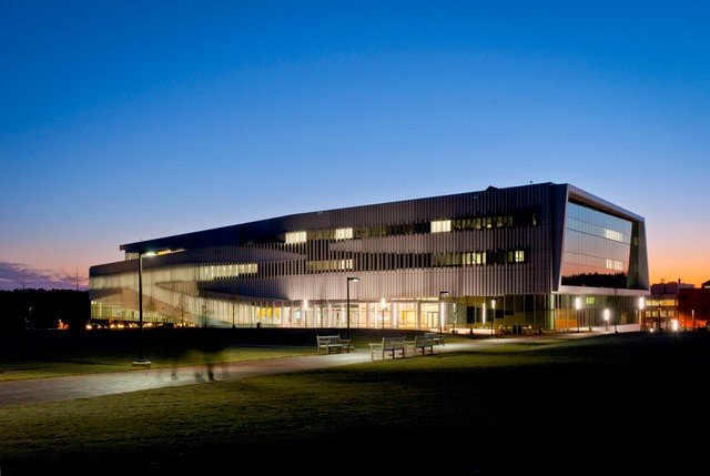 Picture of the NCSU Libraries building at sunset