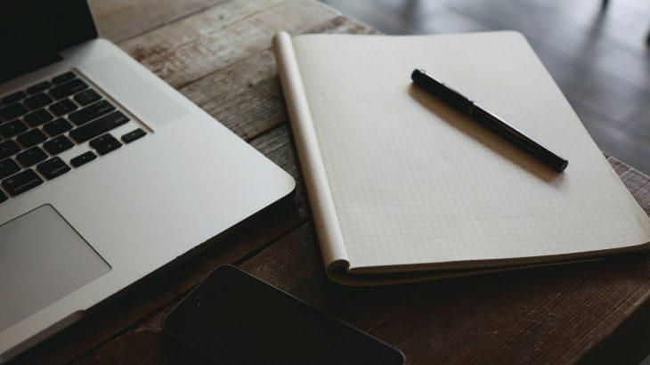 laptop notebook pencil desk
