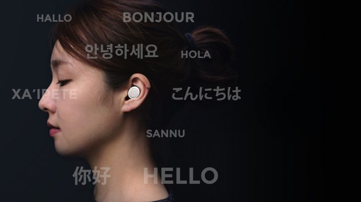 "A woman wearing an Mymanu CLIK earpiece, surrounded by the word ""Hello"" in different languages."